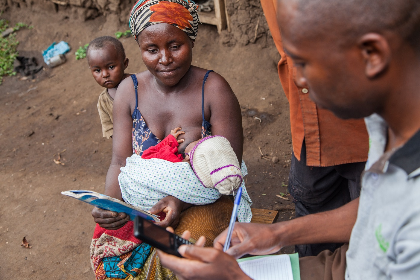 A social worker records the infant's health findings